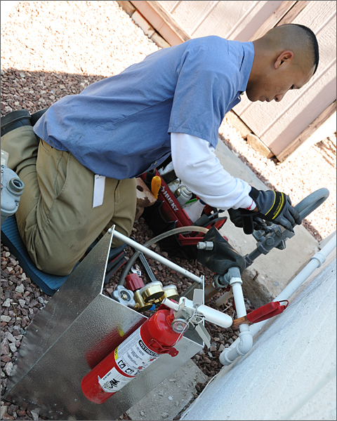 Construction photography - first step in replacing a gas meter is removing the old one, Tucson, Arizona